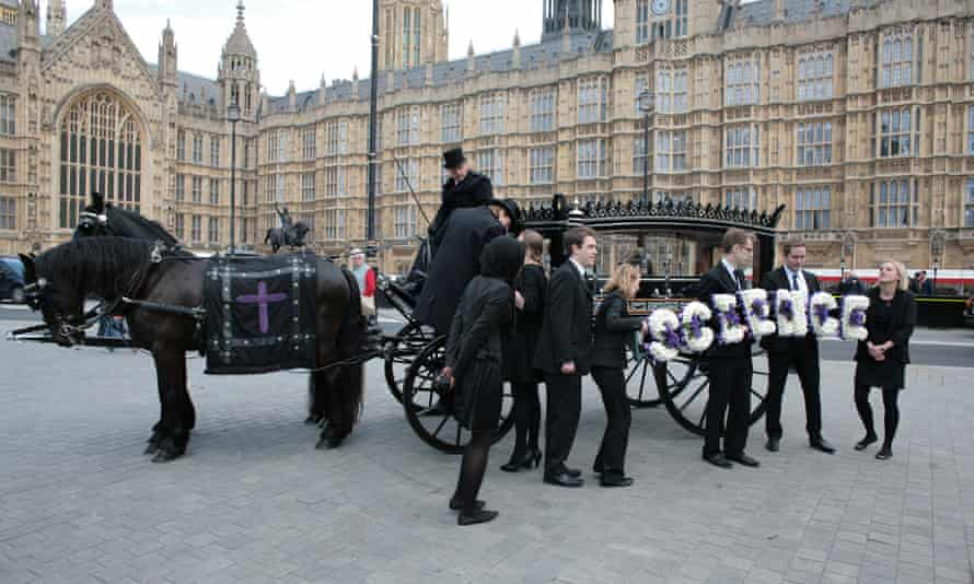 Is the UK science system about to receive a mortal blow? Scientists in a May 2012 protest deliver a petition in a coffin.