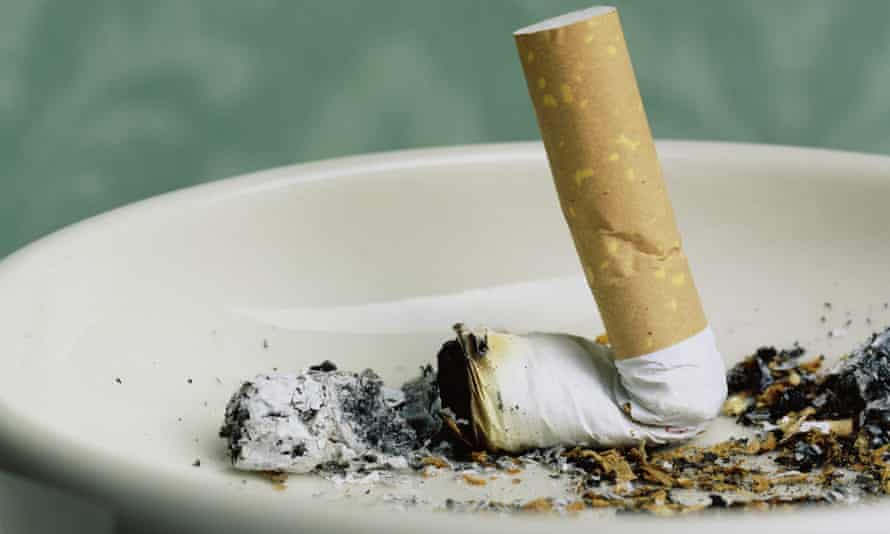 Cigarette stub in ashtray, close-up