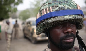 A Nigerian soldier mans a checkpoint in Gwoza, Nigeria – the norm since a state of emergency was declared across the region.