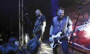 Vlad Telea, who was killed in the blaze, and Alex Pascu of the Romanian metal band Goodbye to Gravity performing before the fire broke out inside Colectiv on 30 October.