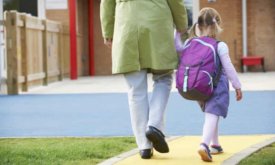 parent taking daughter to school