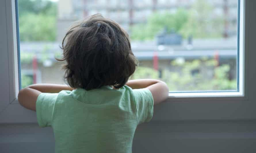 young boy looking out of window