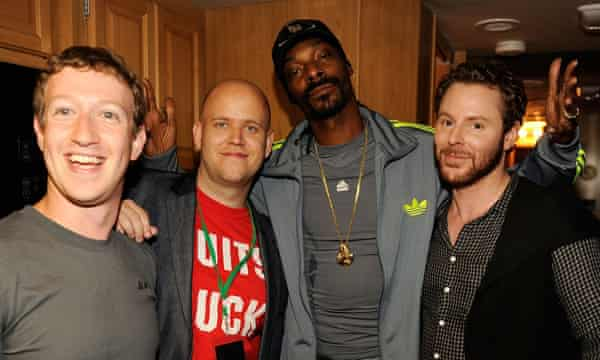 Parker, right, with Facebook founder Mark Zuckerberg, Spotify CEO Daniel Ek and rapper Snoop Dogg in 2011.