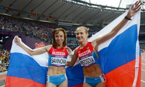 Mariya Savinova (L) celebrating with Russia's bronze medalist Ekaterina Poistogova