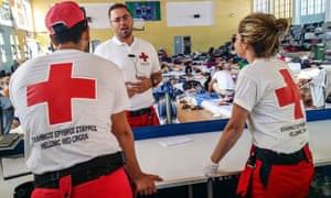 Greek Red Cross volunteers at a temporary shelter set up for refugees in Crete.