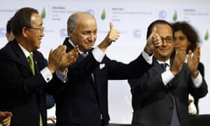 French foreign minister and President of the COP21 Laurent Fabius, center, applauds while United Nations Secretary General Ban Ki-moon, left, and French President Francois Hollande applaud after the final conference of the COP21.