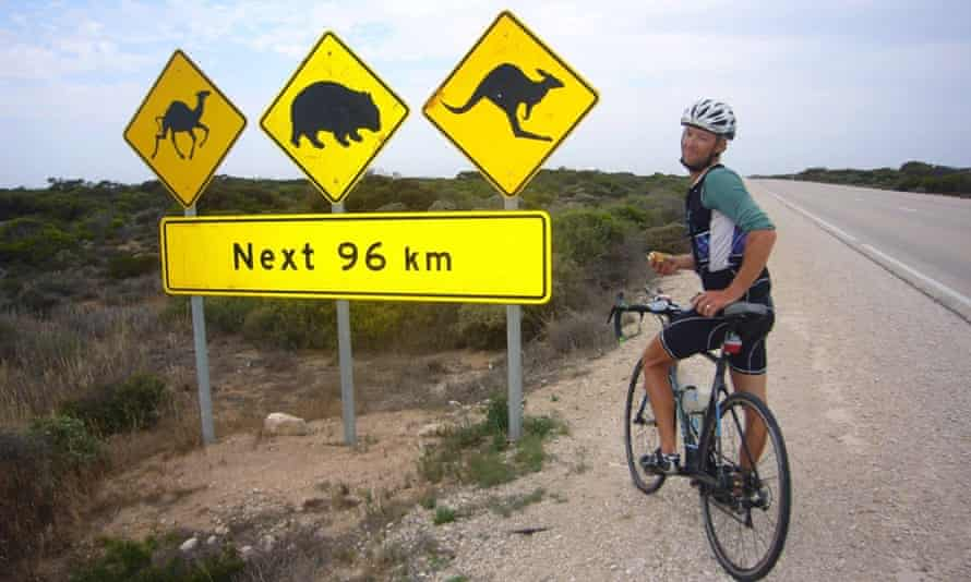 Andrew Nicholson stops for a sandwich as he crosses Australia on his round-the-world challenge.