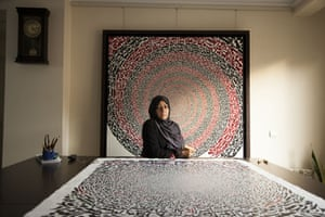 Azra Aghighi, 49, was born in Qom and fell in love with the forms of her written language early on. She studied a traditional form of calligraphy at university and devoted herself full-time to her art once her children had grown. She finds working long hours at her canvasses therapeutic. While religion is a big inspiration, she says it's not at the heart of her practice. She believes that the forms of her letters go beyond the meaning of the words.