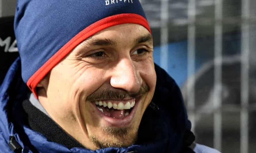 Paris Saint-Germain's Swedish forward Zlatan Ibrahimovic smiles on the bench prior to the French L1 football match between Angers and Paris Saint Germain.