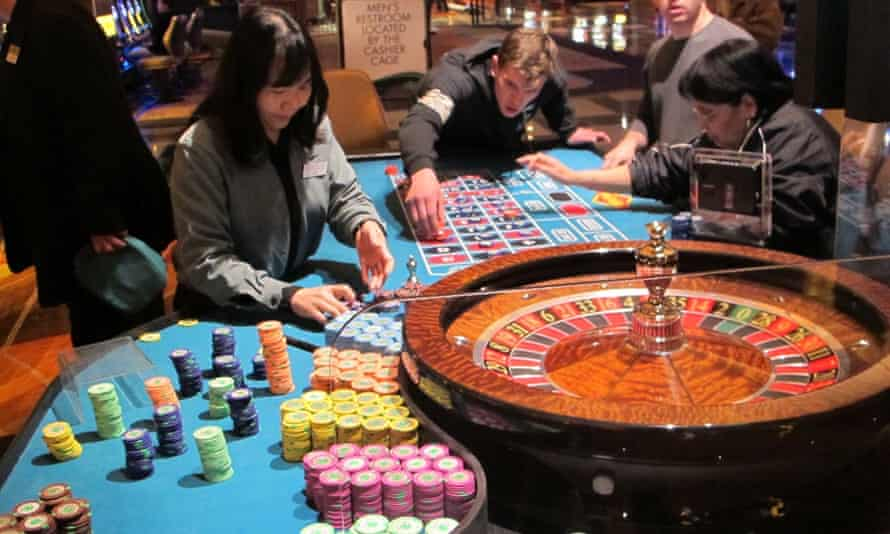 In this April 17, 2015 photo, a dealer counts chips during a game of roulette at the Tropicana Casino and Resort in Atlantic City, N.J.