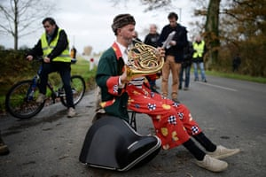 A man plays a French horn during a protest march opposing the creation of an international airport near Nantes