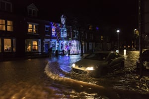 Carlisle, England A car drives through the flooded streets after Storm Desmond caused the River Eden to breach its banks