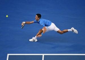 Novak Djokovic plays a shot.