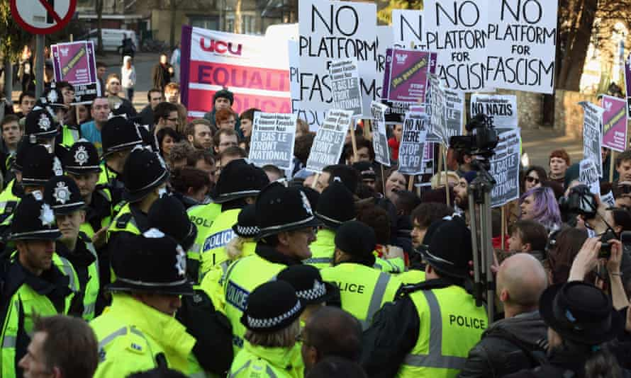 Protesters and police clash at Cambridge university in 2013.