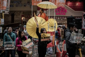 Demonstrators distribute leaflets before the march for democracy in Hong Kong on Sunday.
