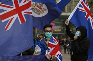 Some protesters were seen waving colonial-era Hong Kong flags.
