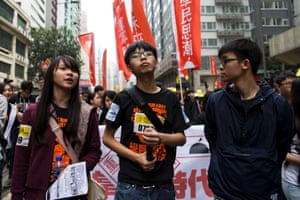 Student leaders (left to right) Agnes Chow, Joshua Wong and Oscar Lai on the march.