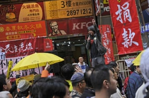 The chairman of the League of Social Democrats, Leung Kwok-hung, also known as Long Hair, yells slogans to demonstrators.