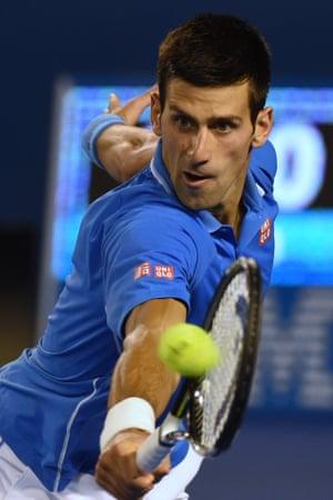 Novak Djokovic hits a return.