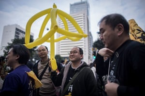 A demonstrator holds a balloon umbrella.