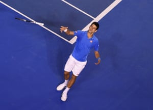 Novak Djokovic throws his racquet into the crowd as he celebrates victory.