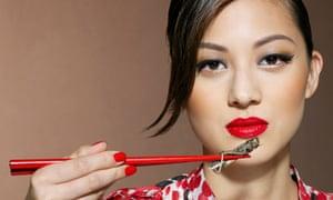 Woman eating grasshopper