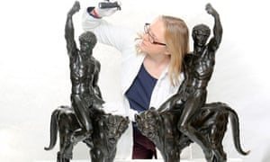 Victoria Avery, keeper of applied arts at the Fitzwilliam Museum, examines the two bronze sculptures thought to be by Michelangelo.