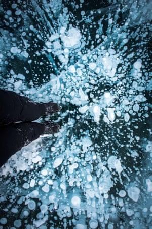 Methane gas bubbles under the frozen surface of Lake Minnewanka