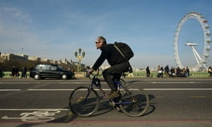 A cyclist on Westminster bridge, one of a record number of people using bikes in London.