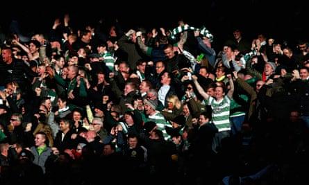Celtic fans celebrate during the Scottish League Cup semi-final against Rangers at Hampden Park.