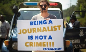 A file photograph dated 04 February 2014 shows a Nairobi-based foreign correspondent posing with a placard to protest against imprisonment of Al Jazeera journalists Peter Greste and his colleagues in Egypt, outside the Egyptian embassy in Nairobi, Kenya.