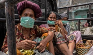 Karo, Indonesia: residents cover their faces after the recent eruption of Mount Sinabungi