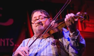 Dave Swarbrick fiddles on stage at Bush Hall in London.