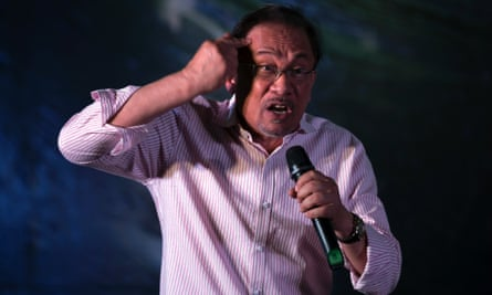 Anwar Ibrahim addresses his supporters on Monday. A Malaysian court has upheld his sodomy conviction.