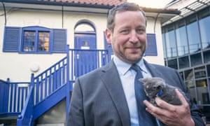 Ed Vaizey smiling with a kitten in his hands