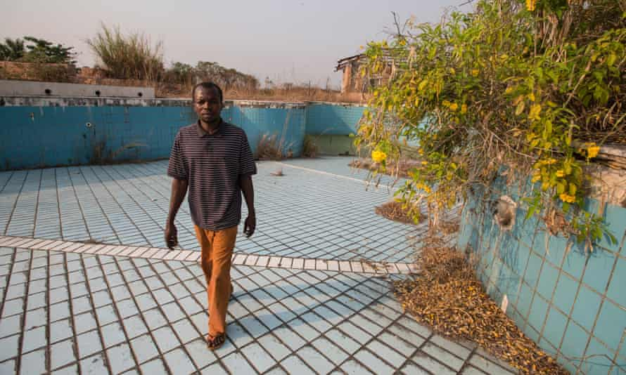 Francois Kosia Ngama in the dried-up swimming pool at the president's palace.