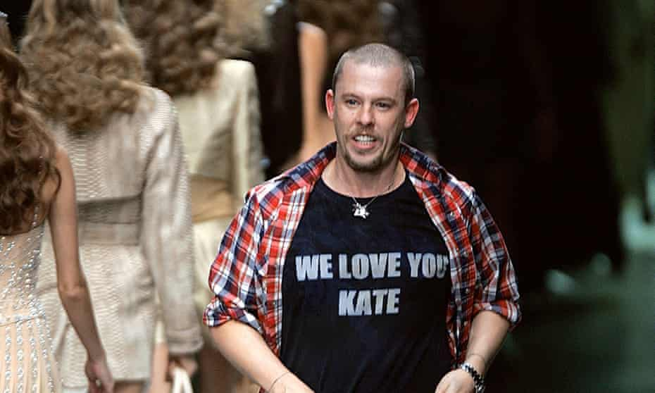 (Alexander McQueen shows his support for Kate Moss at the end of his ready-to-wear spring/summer show in 2010.