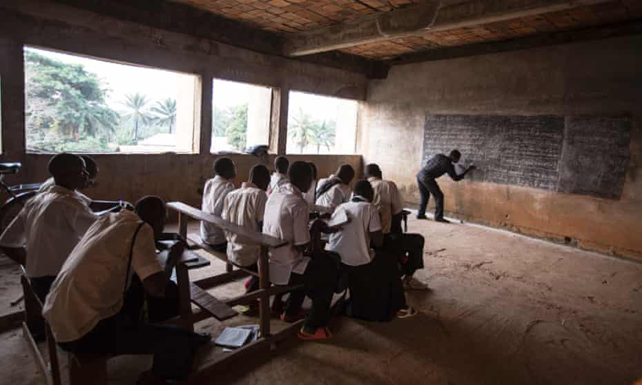 Gbadolite's water ministry building was halted mid-construction and now serves as a school.