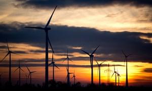 The sun sinks behind wind turbines near Leipzig, Germany.