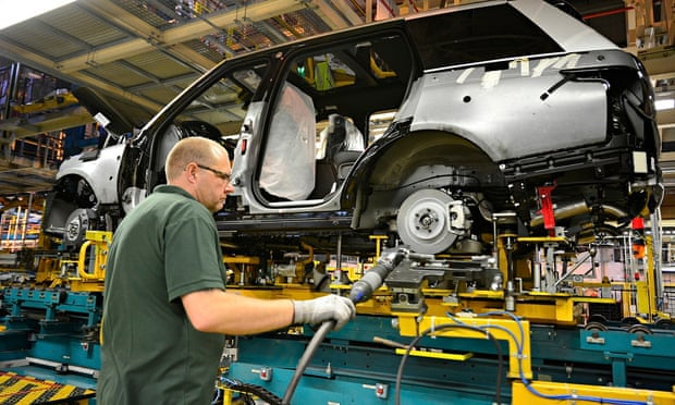 A worker on the assembly line at Jaguar Land Rover in Solihull. Photograph: John Robertson