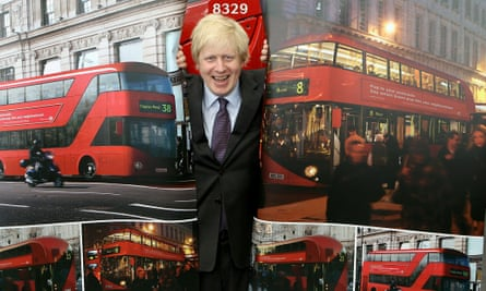 Mayor of London Boris Johnson poses with artists impressions of the design for London's new Routemaster bus on May 17, 2010 in London,.