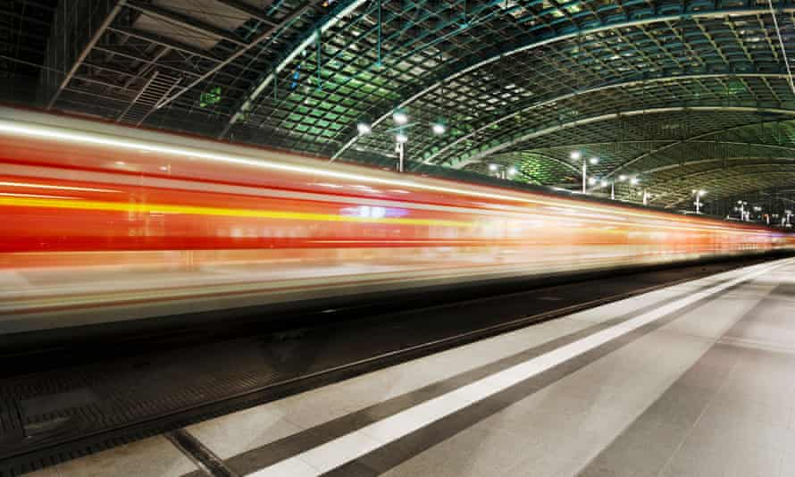 A train speeding past under the arches of the Hauptbanhof station in Berlin
