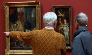 Visitors study paintings at the Dulwich Picture Gallery in an effort to find the replica sourced from a Chinese workshop and hung in the original frame.