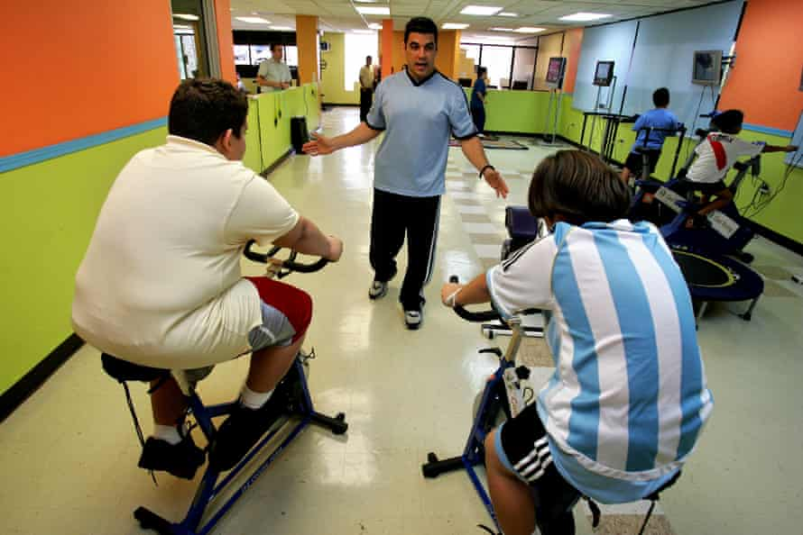 Puerto Rican children train on stationary bikes inside the gym in Guaynabo, Puerto Rico.