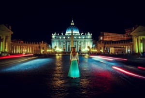 woman standing in front of st peters square at night