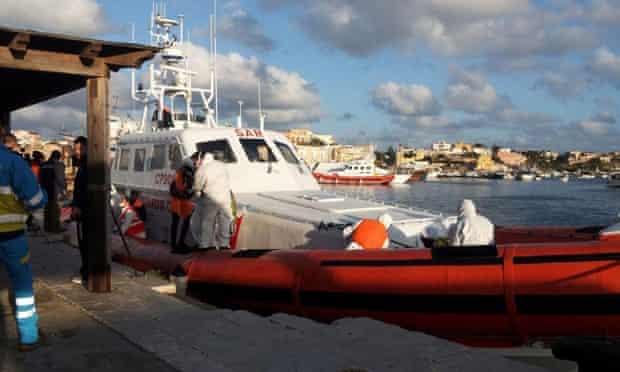 An Italian coastguard boat arrives at Lampedusa on 11 February.