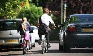 Children cycling along a road
