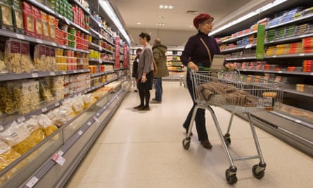 Shoppers browse in a Waitrose store.