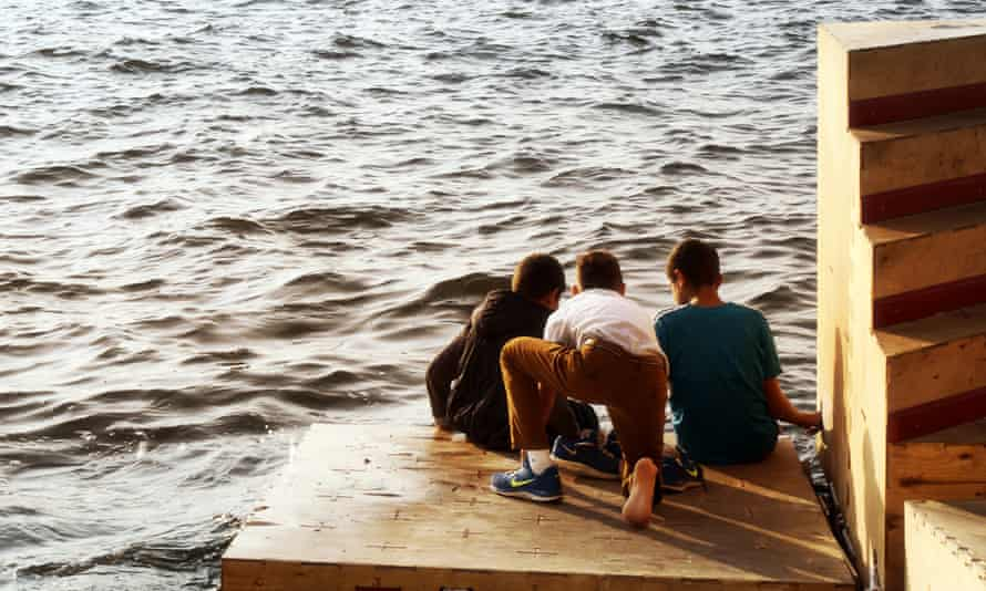 Children play on the floating docks in Izmir