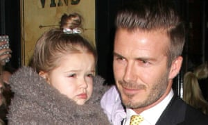 Daddy's girl: Harper Beckham with father David.
